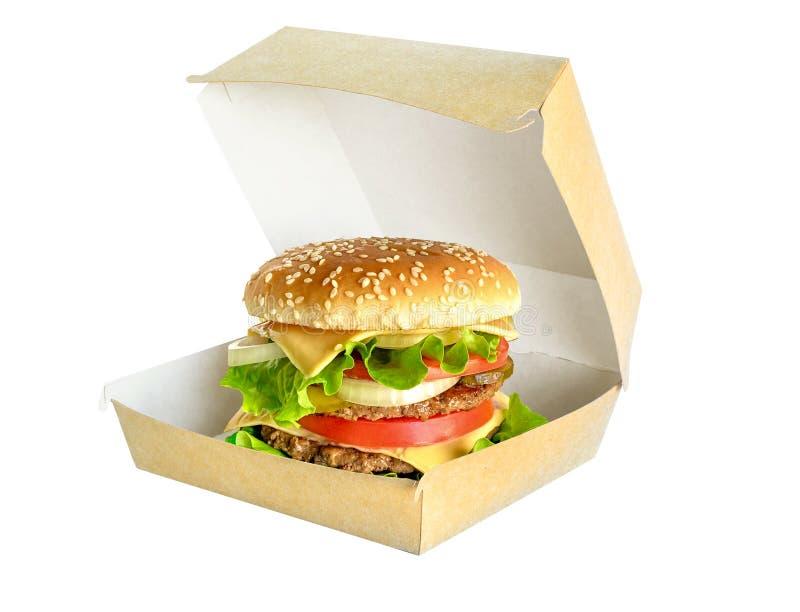 Grande hamburger in scatola di cartone isolata su bianco fotografie stock