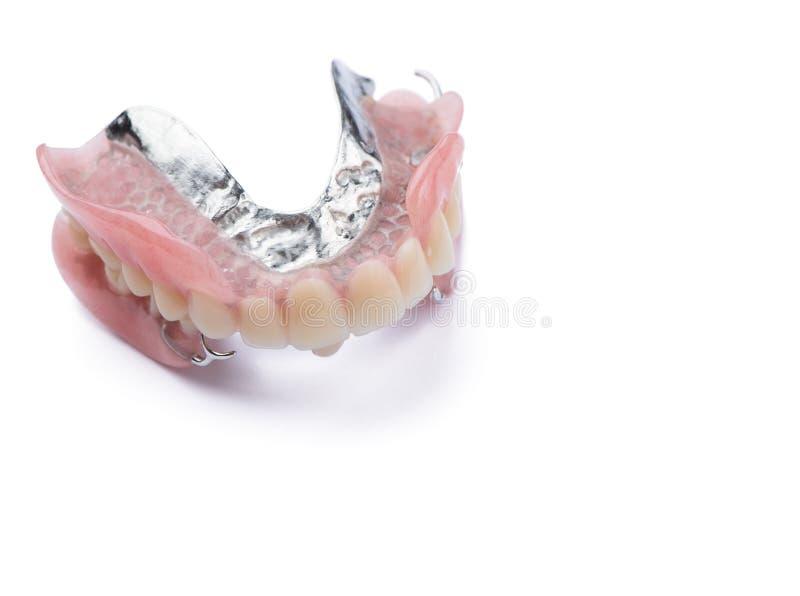 Grande immagine di una protesi dentaria moderna su un fondo bianco immagine stock libera da diritti