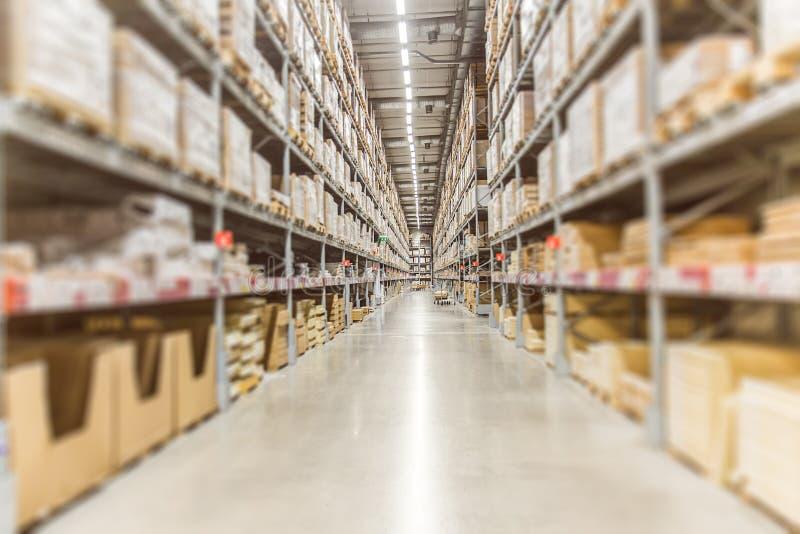 Grande inventário Estoque dos bens do armazém para o transporte logístico fotografia de stock