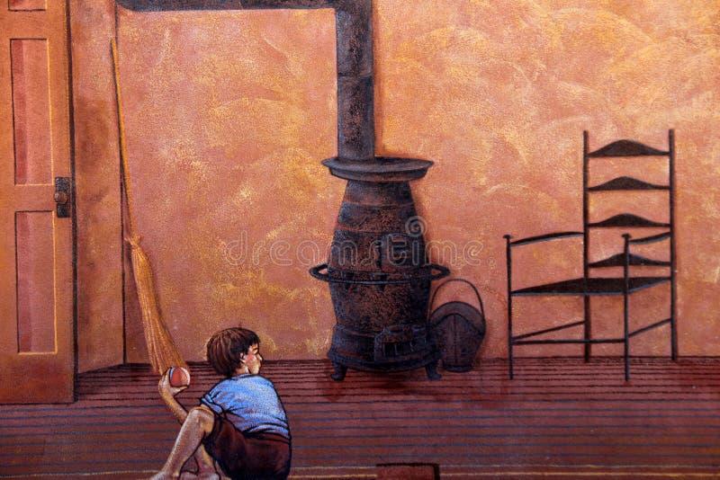 Grande peinture murale de jeune garçon se reposant sur le magasin de plancher en général pendant la vie le long du canal mystérie photo libre de droits
