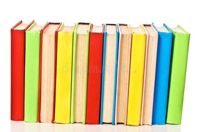 Grande pile de livres dans le cache dur, vue de dos photos stock