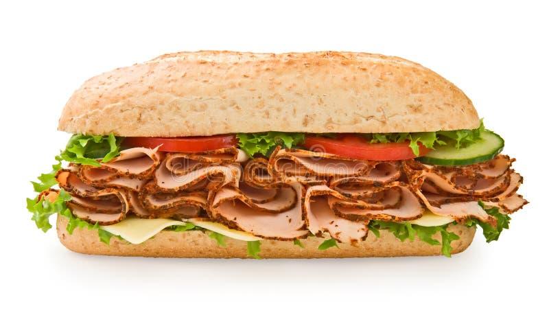 Grande sanduíche de peru inteiro da grão imagem de stock royalty free