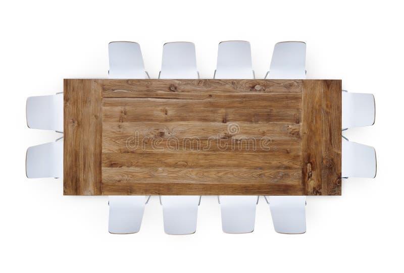 Grande tabela de reunião de madeira com doze cadeiras fotos de stock royalty free