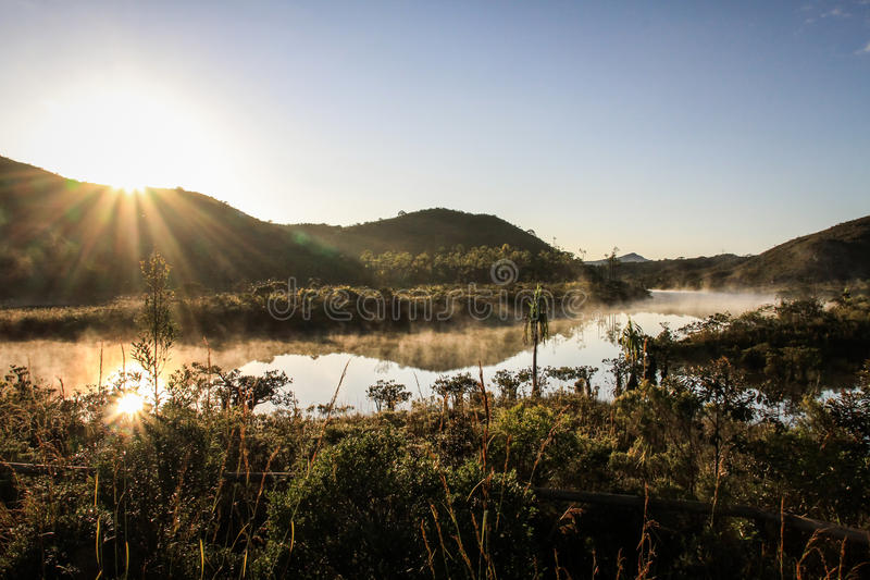 Sunrise over a river, South of Grande Terre, New Caledonia. Grande Terre is the largest and principal island of New Caledonia. British explorer James Cook royalty free stock images