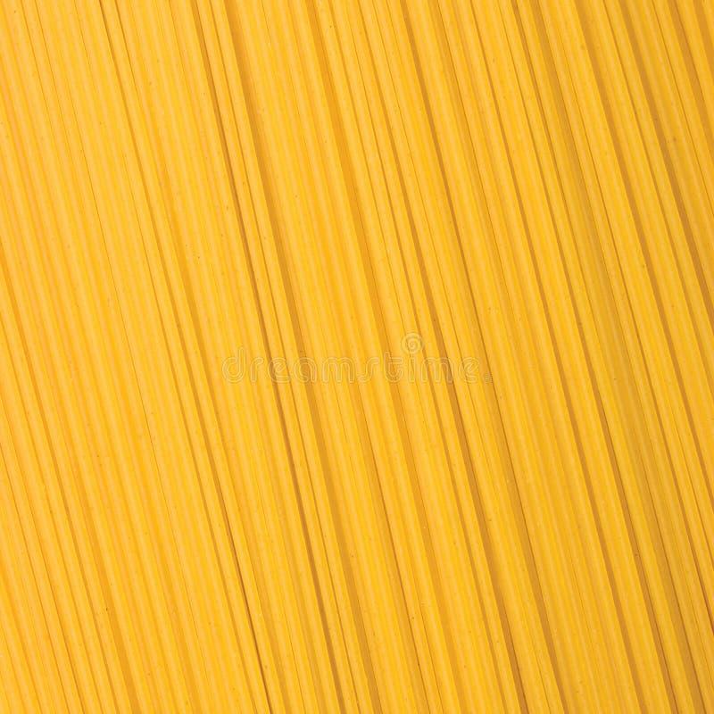 Grande teste padrão macro detalhado do fundo tradicional do close up da massa dos espaguetes, vertical fotos de stock