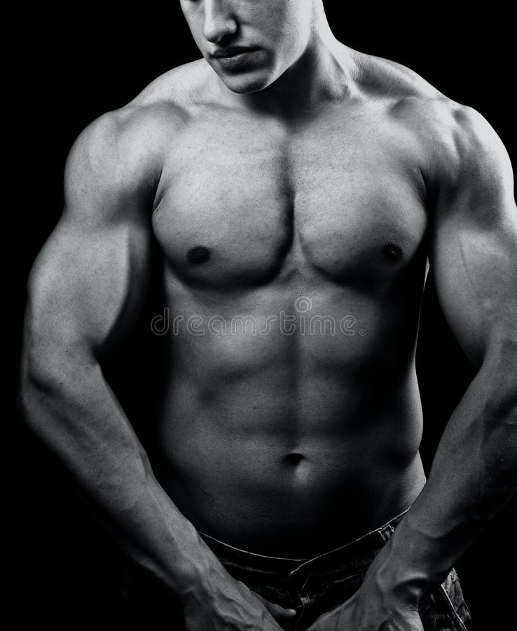 Grande uomo sexy muscolare con l'ente potente fotografia stock