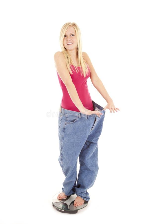 Grandes échelles de pantalon heureuses image libre de droits