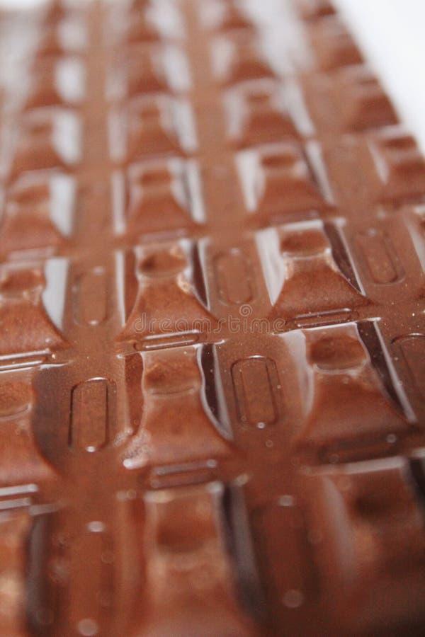 Grandes barres de chocolat brunes de plan rapproché rectangulaire de forme comme fond photos libres de droits