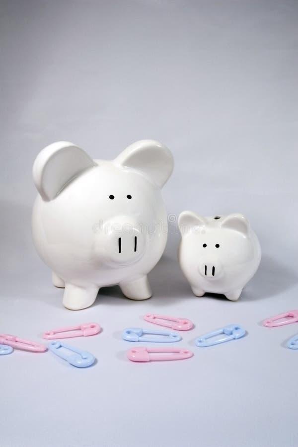 Grandes e bancos Piggy pequenos foto de stock royalty free