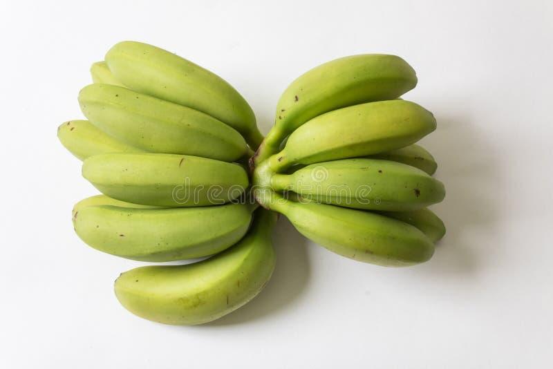 Grandes e grupos pequenos de bananas verdes e amarelas do bebê imagens de stock royalty free
