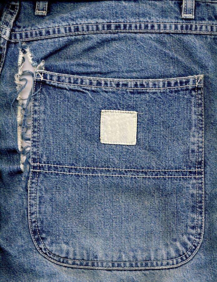 Grandes poche et déchirure de denim image stock