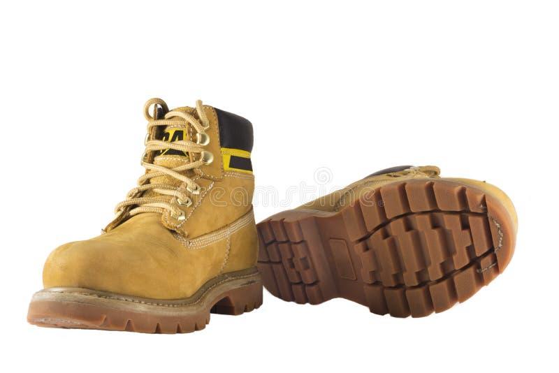 Grandes sapatas amarelas com solas e laços ásperos fotos de stock