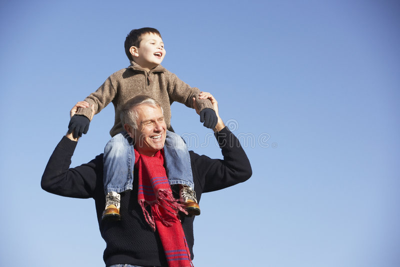 Download Grandfather Carrying Grandson On His Shoulders Royalty Free Stock Images - Image: 7942089
