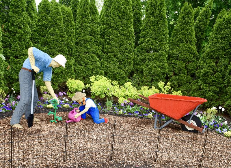 Grandfather and Child: Wheelbarrow. This is a Spring picture of a piece of public art titled: Corn Spider, on exhibit at the Morton Arboretum in Lisle, Illinois stock photos