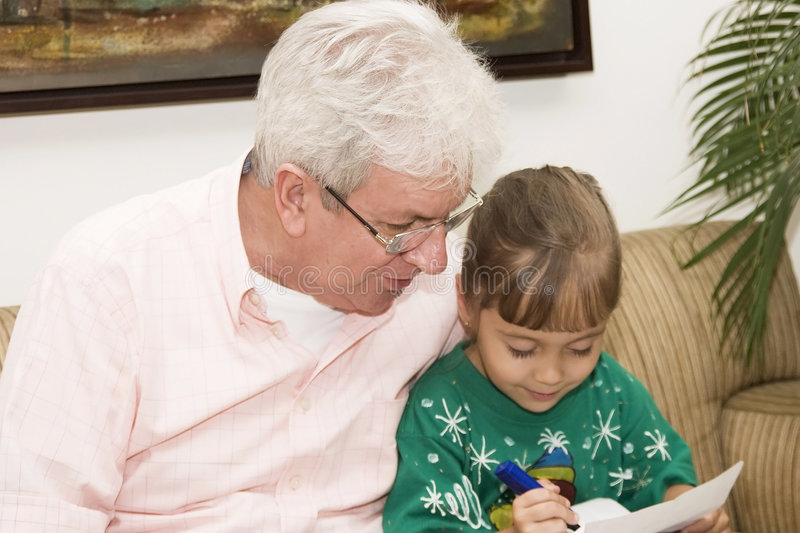 Grandfather enjoying with his granddaughter royalty free stock photo