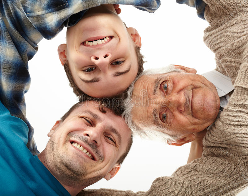 Grandfather, father and son looking down into camera royalty free stock image