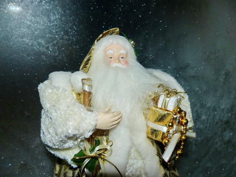 Grandfather Frost Santa Claus, St. Nicholas, Joulupukki with gifts on the background of the night frosty starry sky. royalty free stock photos