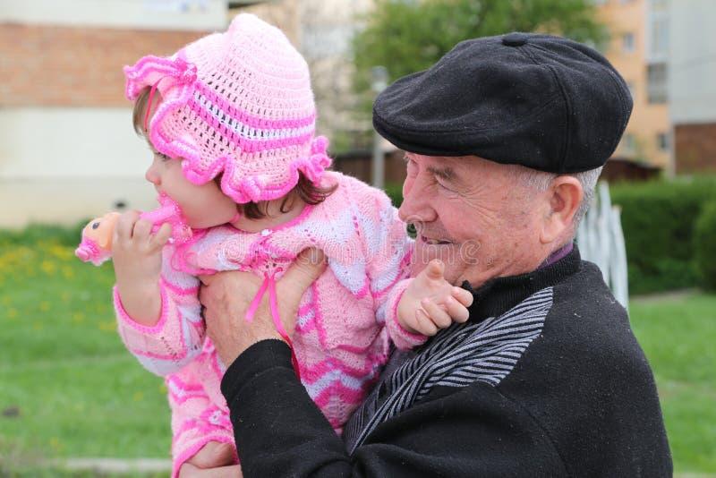 Grandfather girl stock photo