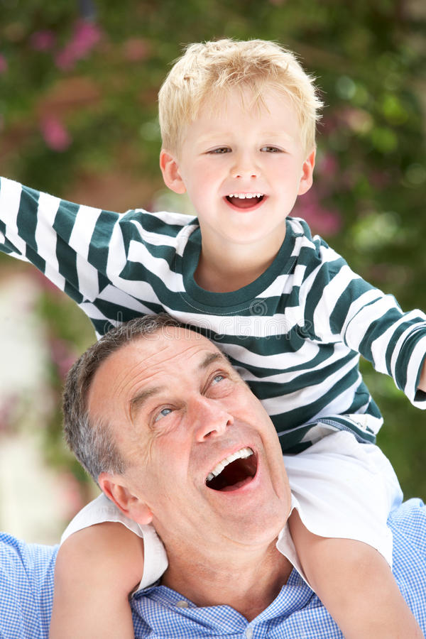 Download Grandfather Giving Grandson Ride On Shoulders Stock Image - Image: 27273609