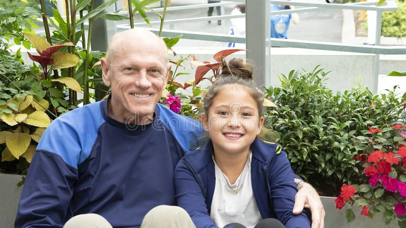 Grandfather and granddaugher enjoying a moment together stock image