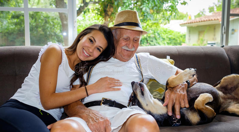 Grandfather and Granddaughter. Elderly eighty plus year old men with granddaughter in a home setting royalty free stock image