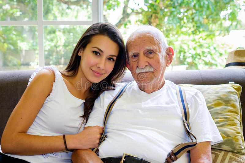 Grandfather and Granddaughter. Elderly eighty plus year old men with granddaughter in a home setting stock images