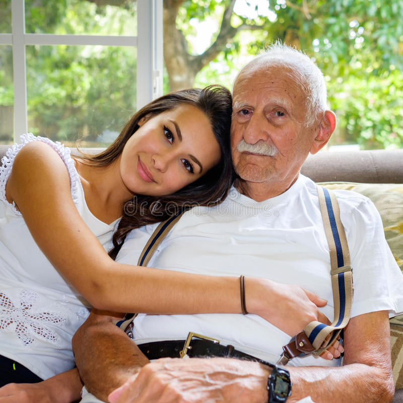 Grandfather and Granddaughter. Elderly eighty plus year old men with granddaughter in a home setting stock photography