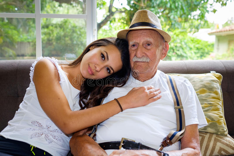 Grandfather and Granddaughter. Elderly eighty plus year old men with granddaughter in a home setting stock image
