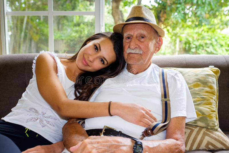 Grandfather and Granddaughter. Elderly eighty plus year old men with granddaughter in a home setting royalty free stock photography