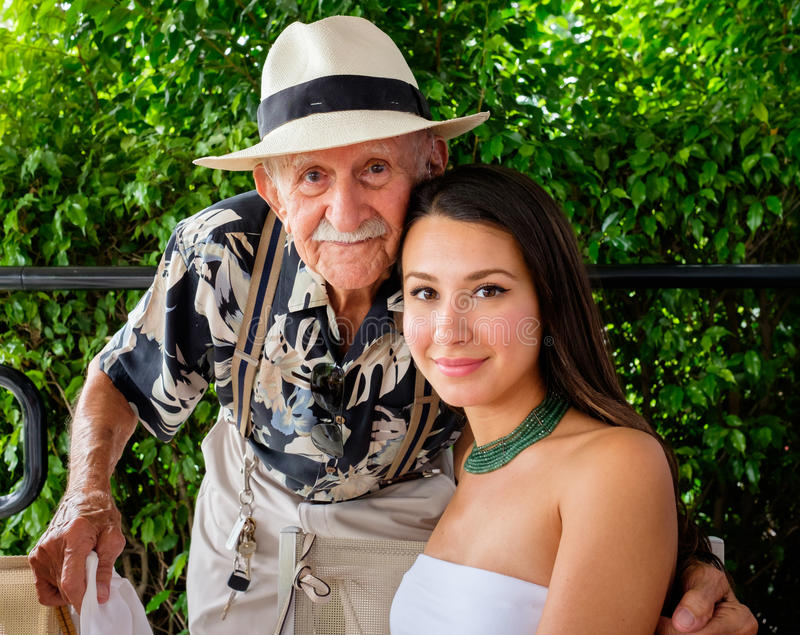 Grandfather and Granddaughter. Elderly eighty plus year old men with granddaughter in a outdoor setting royalty free stock photos