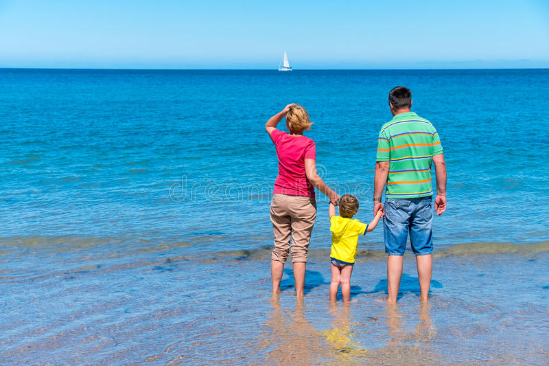 Grandfather and grandmother with grandson holding hands royalty free stock images