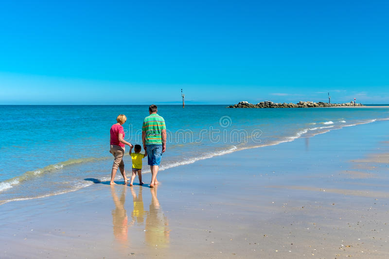 Grandfather and grandmother with grandson holding hands stock photography