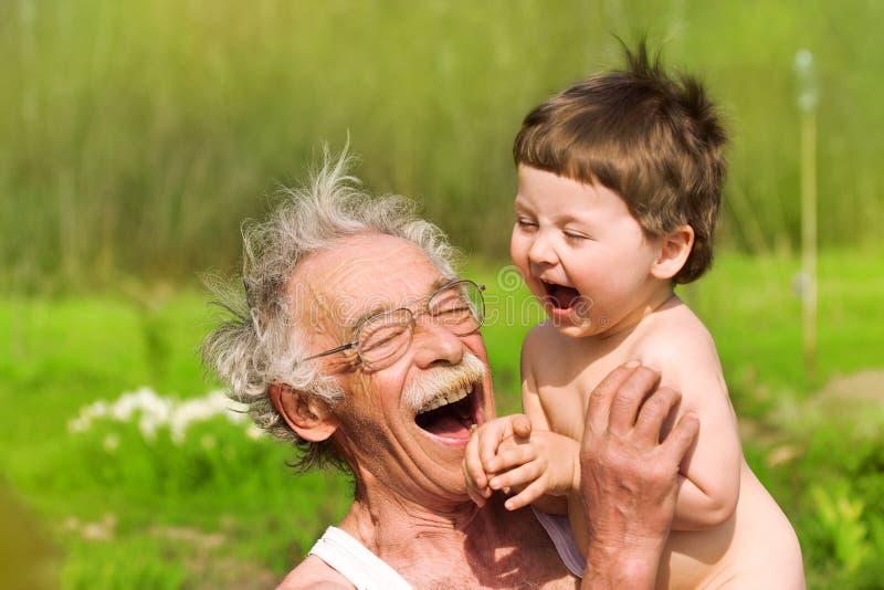 Grandfather and grandson stock photos