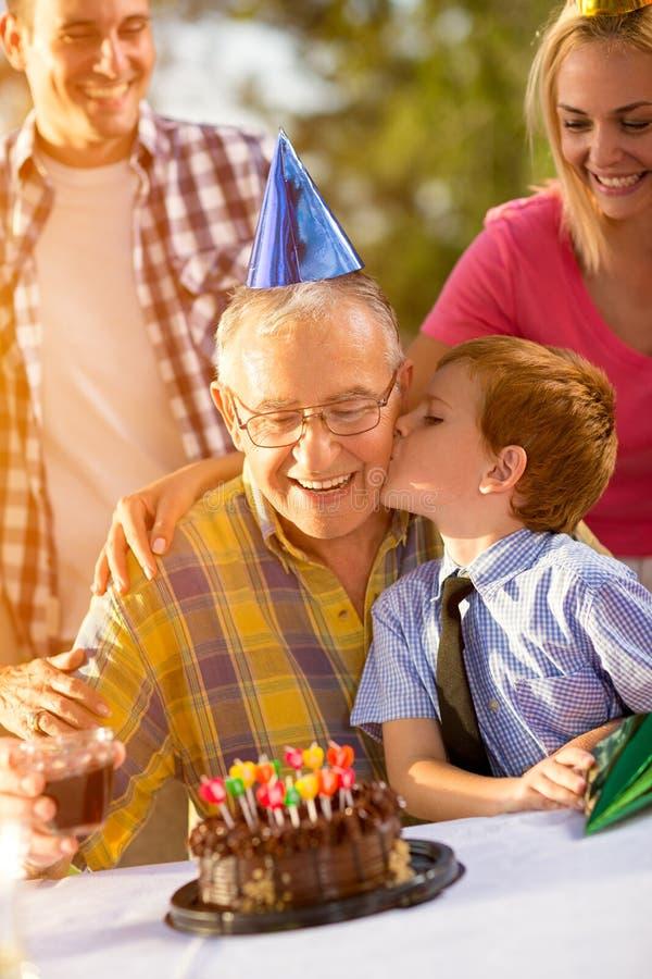 Grandfather and grandson celebrating birthday royalty free stock photos