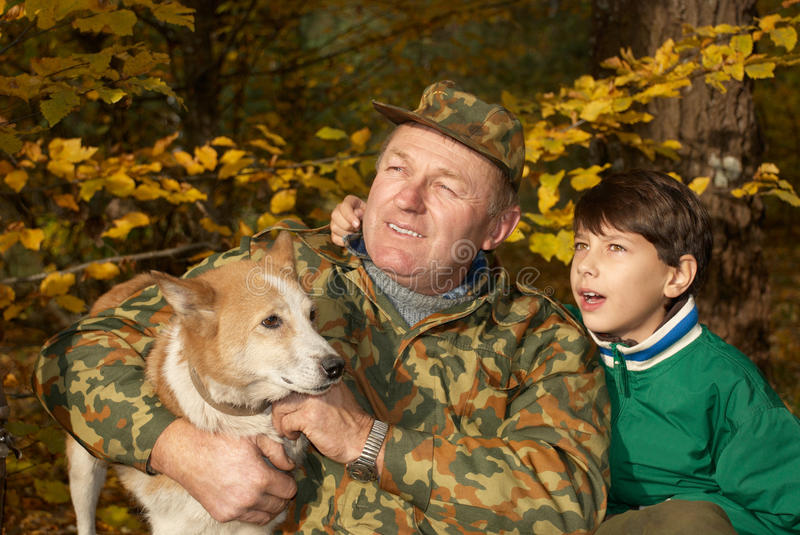 Grandfather, grandson and dog stock photo