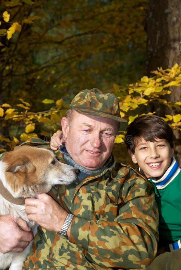 Grandfather, grandson and dog stock photos