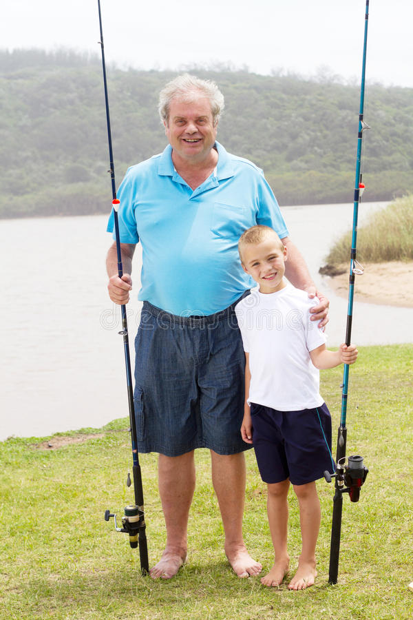 Grandfather grandson fishing royalty free stock photo