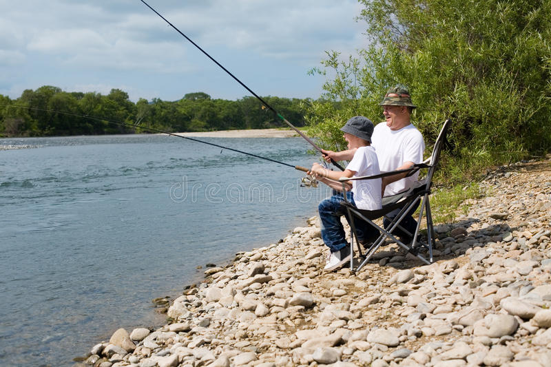 Download Grandfather And Grandson Fishing Stock Photo - Image: 25709856