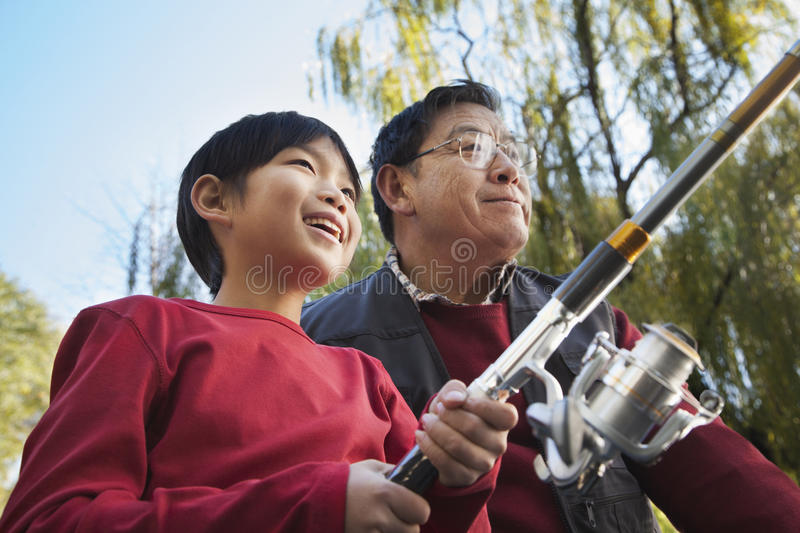 Grandfather and grandson fishing portrait stock image