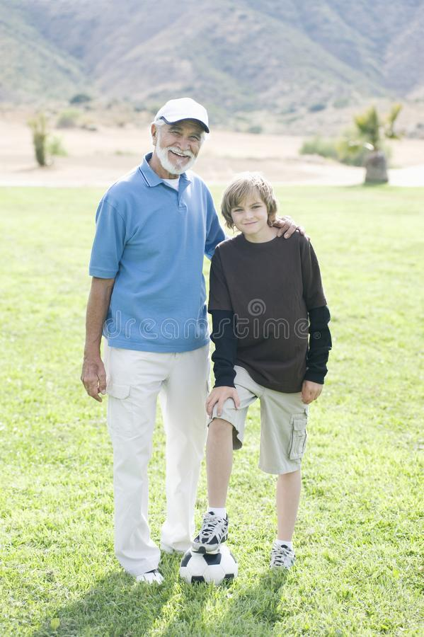 Grandfather And Grandson With Football royalty free stock photo