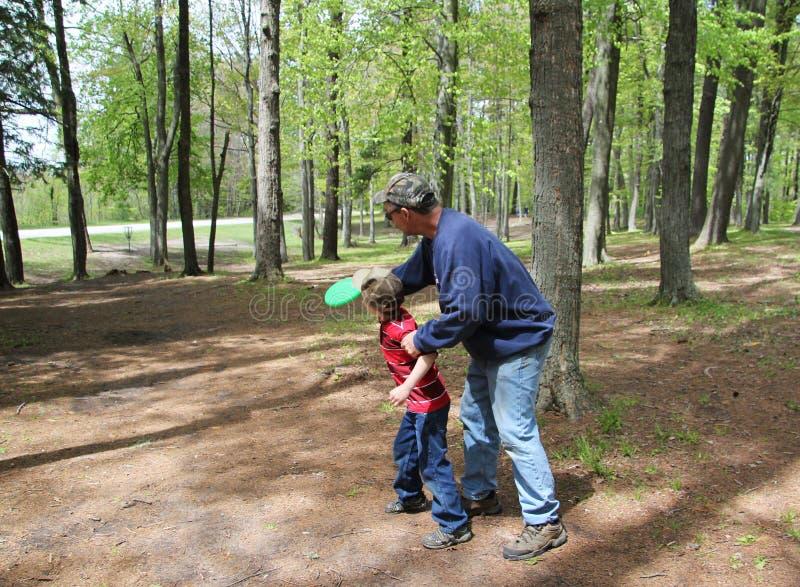 Grandfather Grandson Frisbee Golf stock image