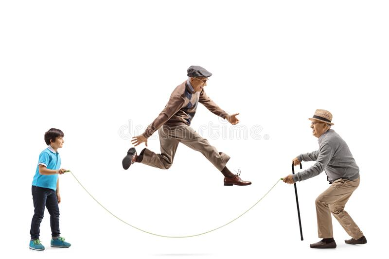 Grandfather and grandson holding a rope and an elderly man skipping royalty free stock image