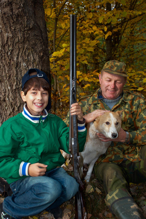 Grandfather and grandson hunting royalty free stock photography