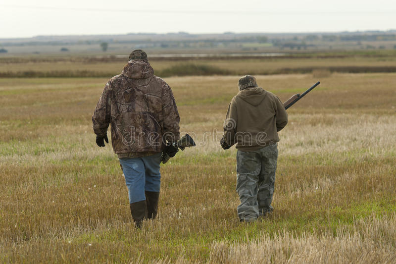 Grandfather and Grandson. Out hunting together stock image