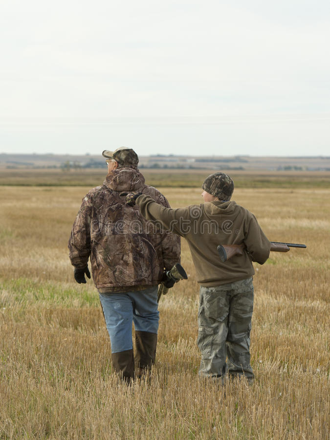 Grandfather and Grandson. Out hunting together stock photos