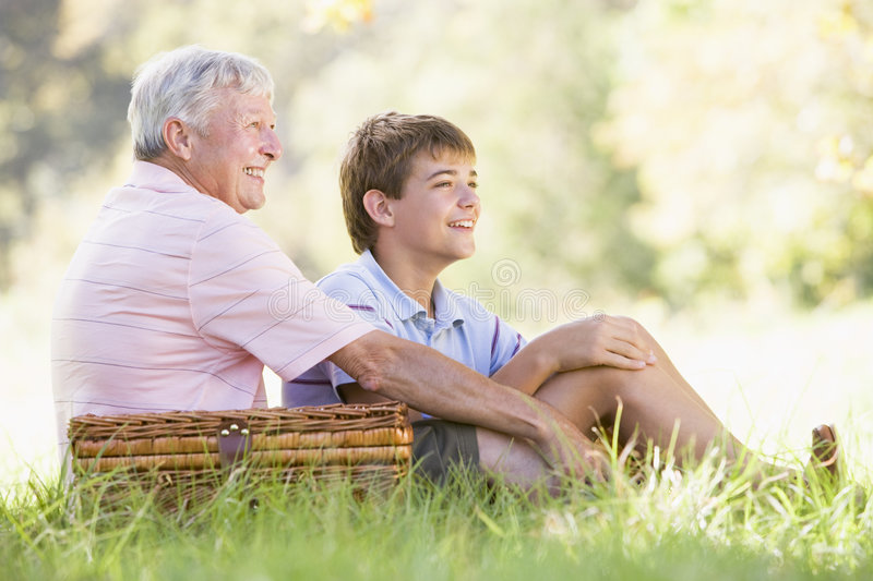 Grandfather and grandson at a picnic smiling royalty free stock photos