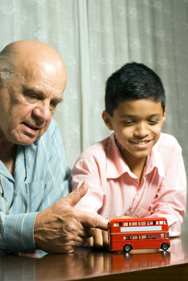 Grandfather And Grandson Sitting On Table - Vertic Royalty Free Stock Image