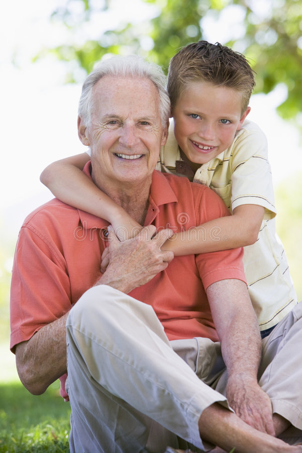 Grandfather And Grandson Smiling Stock Images