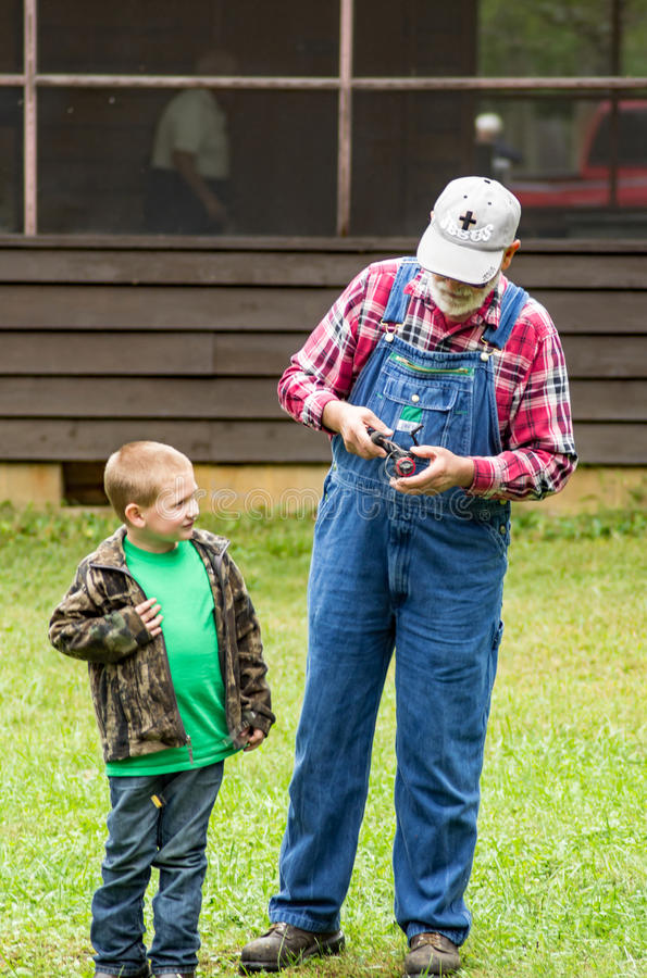 Grandfather and Grandson Trout Fishing stock image