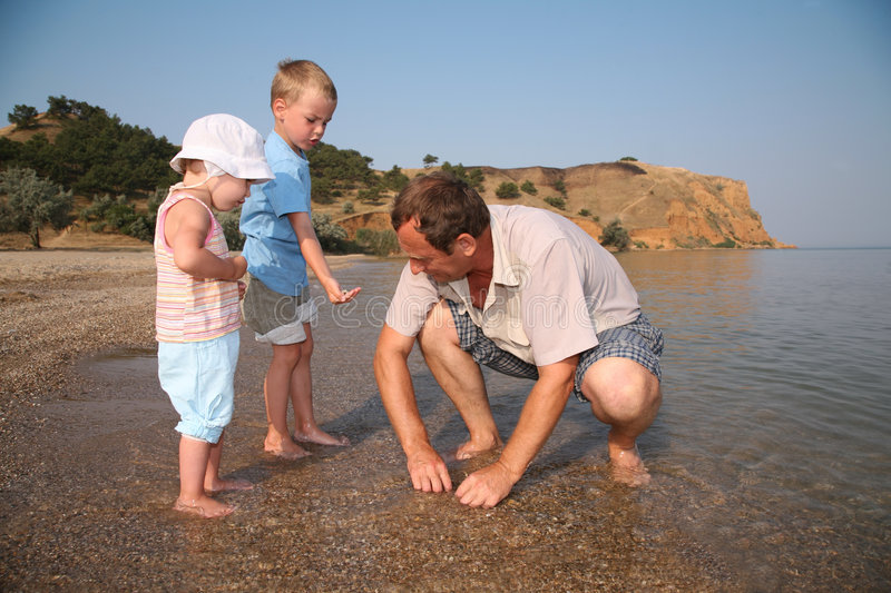 Grandfather with grandsons stock images